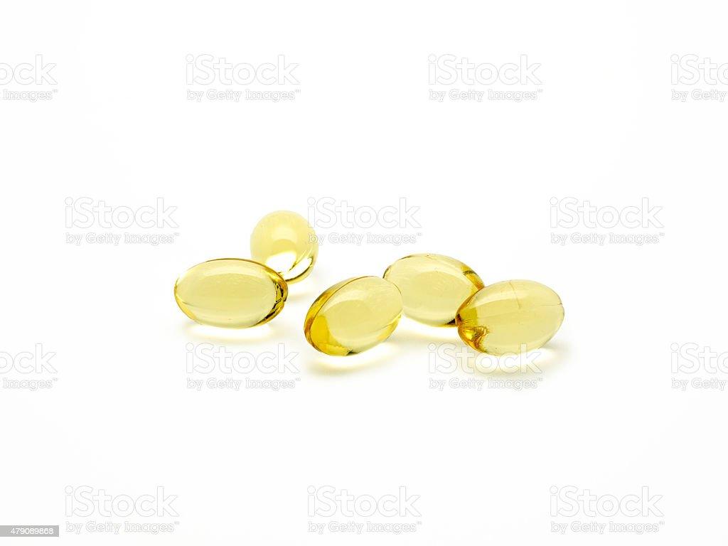 Onagra pílulas isoladas óleo foto royalty-free