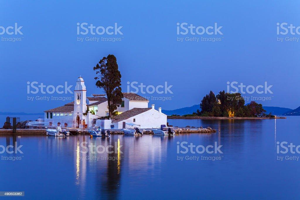 Evening scene of Vlacherna monastery and Pontikonisi island, Kan stock photo