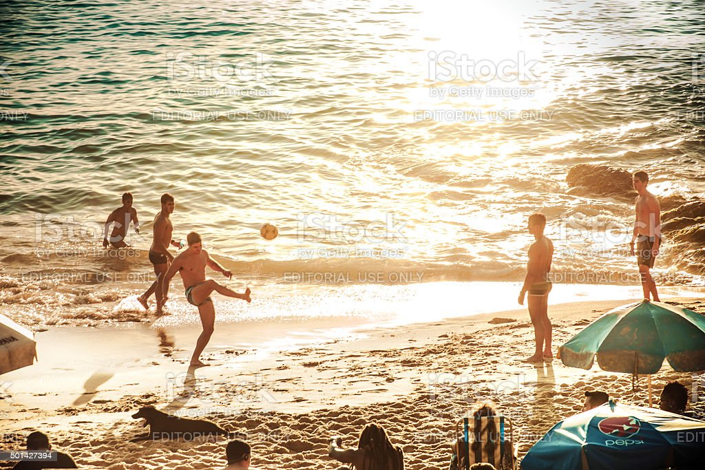 evening scene with soccer at Barra Beach in Salvador Brazil stock photo