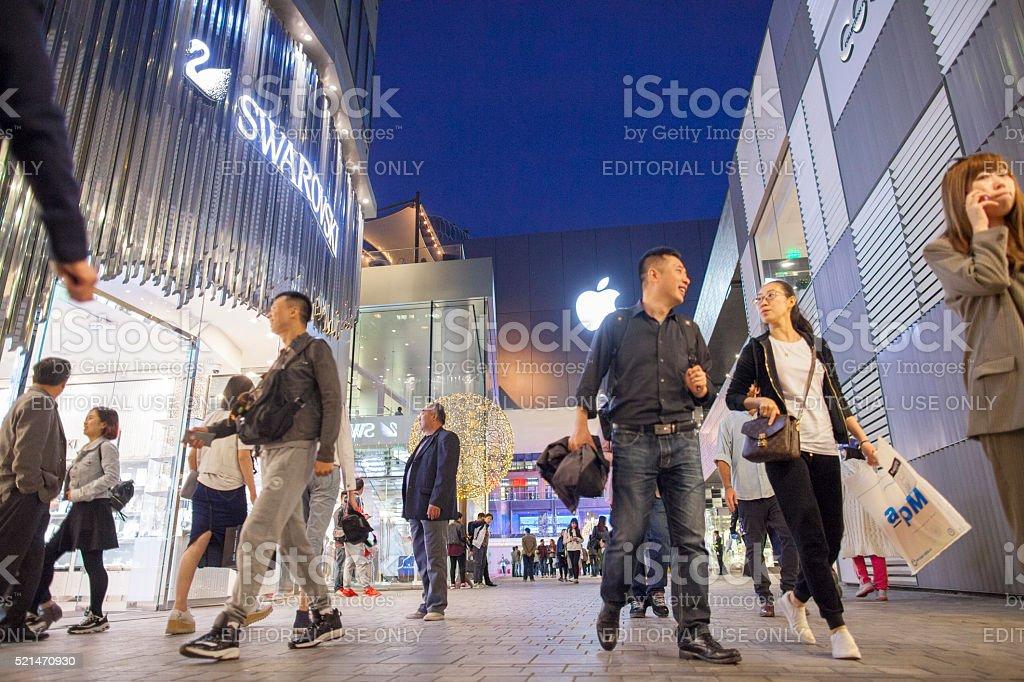 Evening shoppers at Sanlitun's Taikooli outdoor mall stock photo