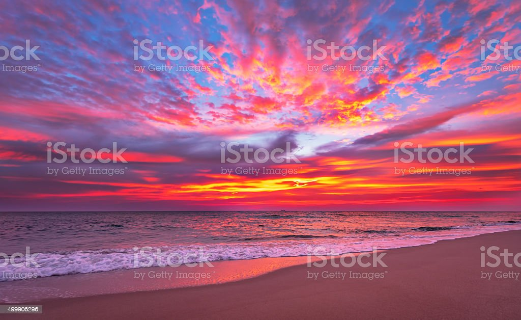 Evening sky with dramatic clouds over the sea. stock photo
