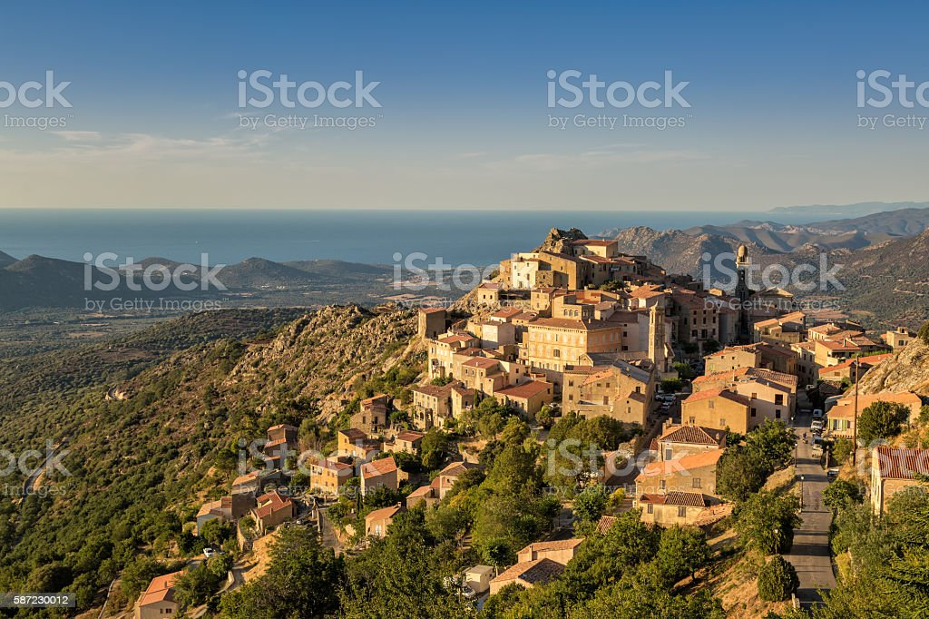 Evening sun on mountain village of Speloncato in Corsica stock photo