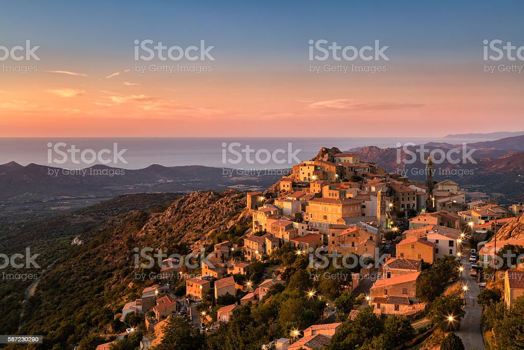Evening sunshine on mountain village of Speloncato in Corsica stock photo