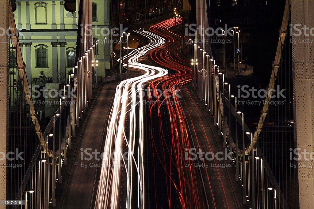 evening traffic on the bridge royalty-free stock photo