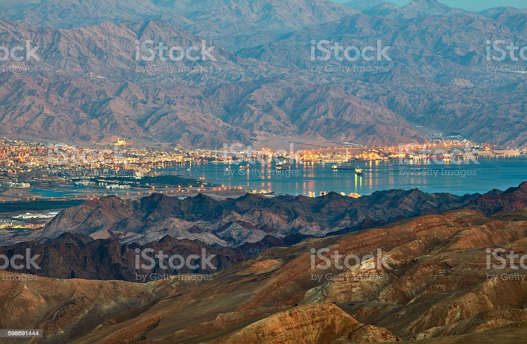 Evening view from Eilat mountains to aqaba gulf. Israel stock photo