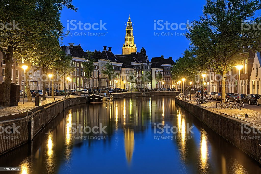 Evening view of Aa river with tower of A-Church, Groningen stock photo