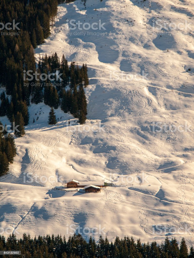 Evening view of alpine hut in the steep slope. Winter backountry ski touring area, Austrian Alps, Europe stock photo