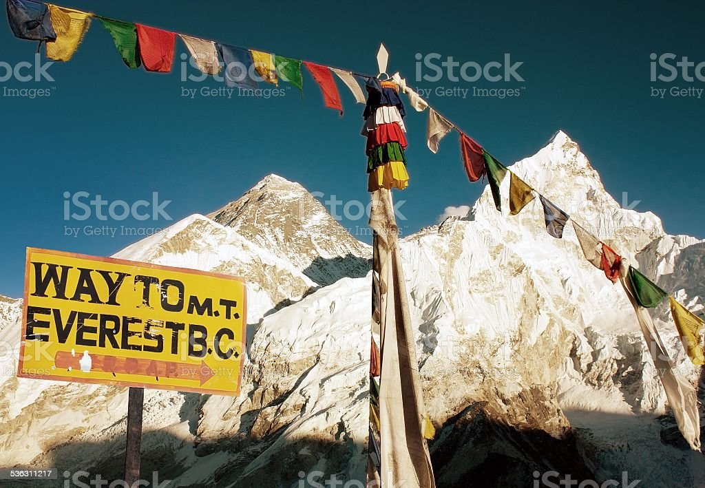 evening view of Everest with buddhist prayer flags stock photo