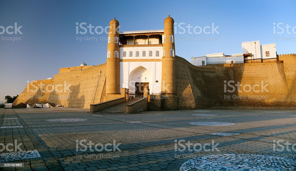 evening view of fortres Ark - Ark entrance - City of Bukhara stock photo