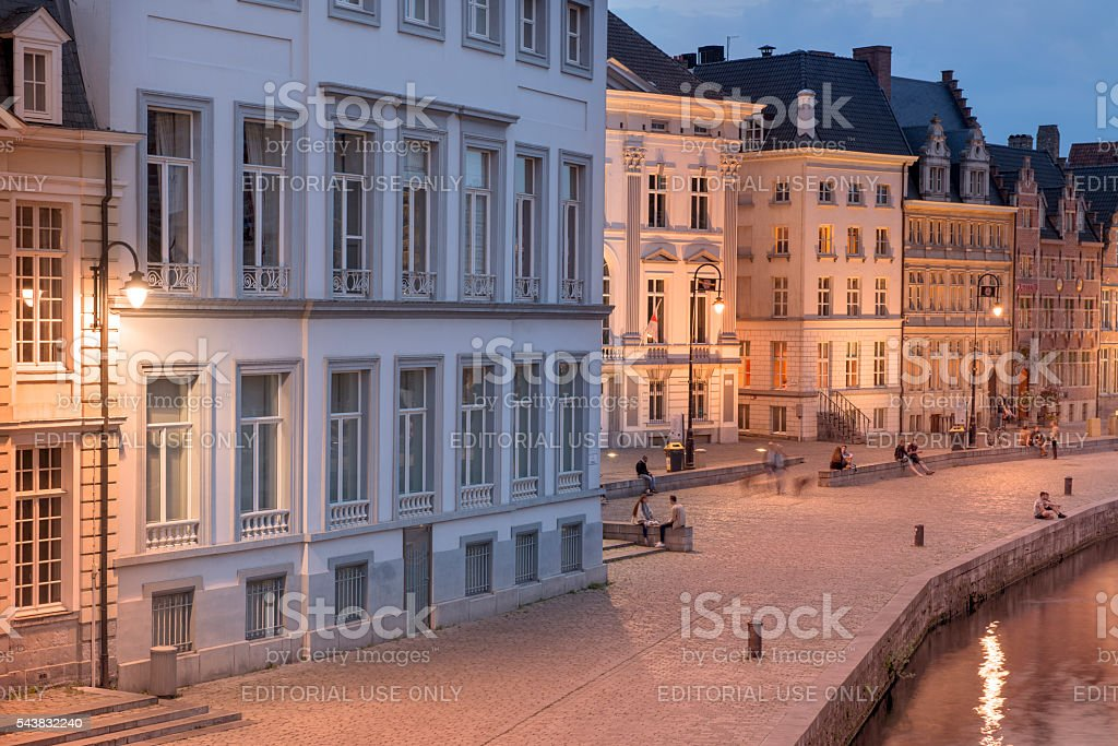 Evening view of illuminated buildings and tourists. Ghent, Belgium stock photo