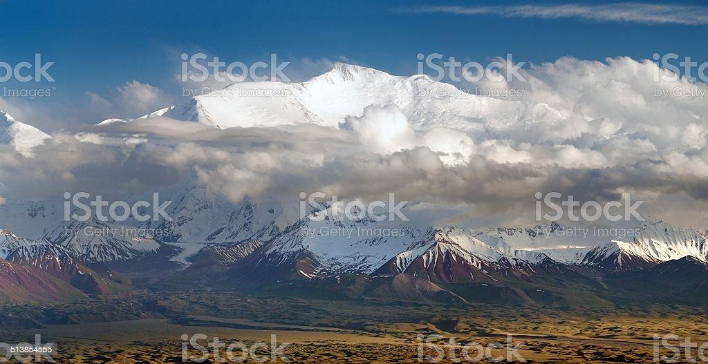 Evening view of Lenin Peak from Alay range stock photo