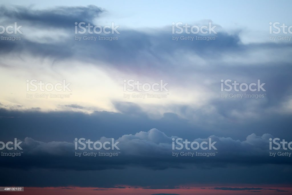 Evening white blue and red cloudy sky stock photo