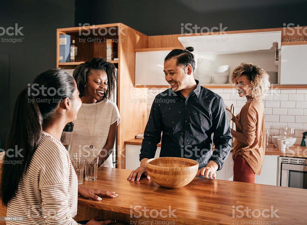 Evening with friends in new condo stock photo