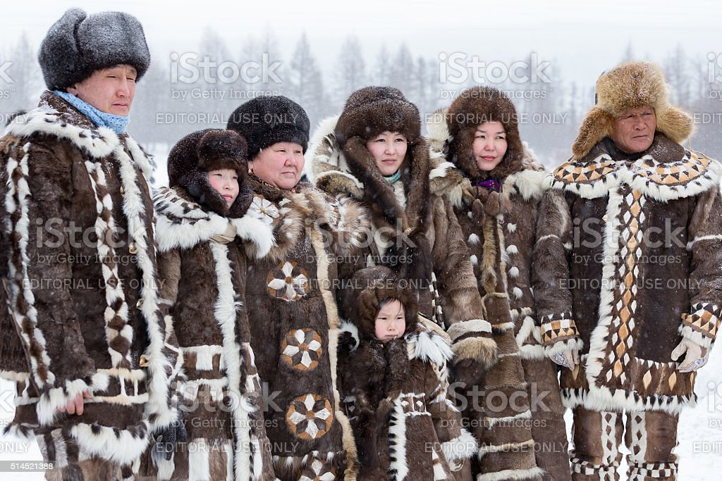 Evenk family in national costumes stock photo