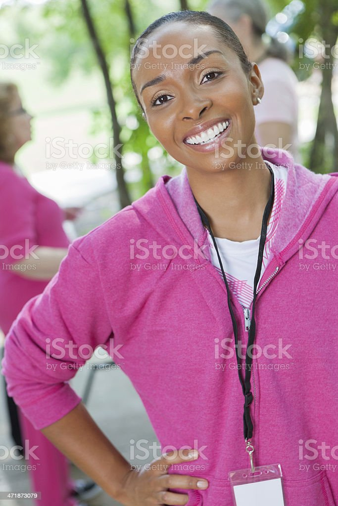 Event organizer at breast cancer awareness charity race royalty-free stock photo