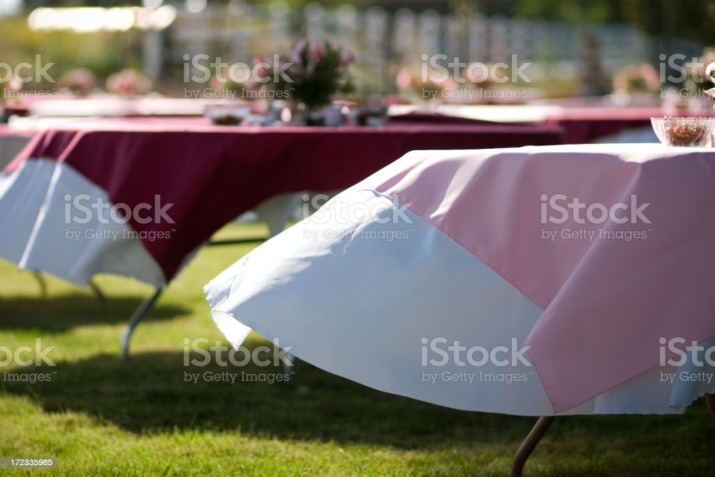 Event Tables with Cloth Blowing in Wind royalty-free stock photo
