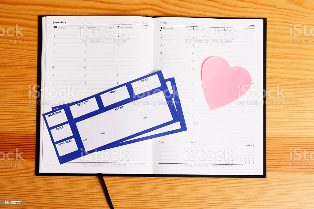 Event tickets on agenda with heart shaped note royalty-free stock photo