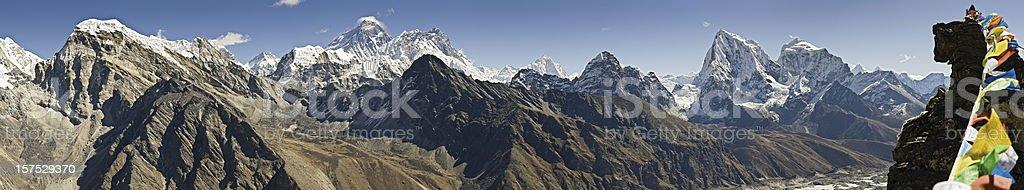 Everest prayer flags peaks pinnacles Sagarmatha Khumbu Himalaya panorama Nepal stock photo