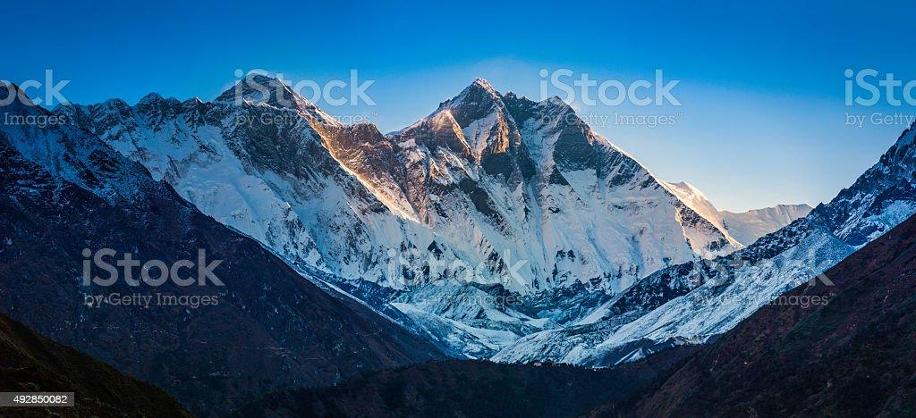 Everest sunrise above Tangboche Monastery Khumubu Valley Himalaya mountains Nepal stock photo