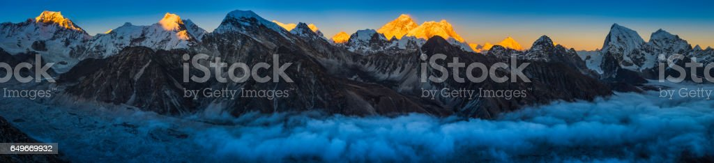 Everest sunset glow above clouds Himalaya mountain peaks panorama Nepal stock photo