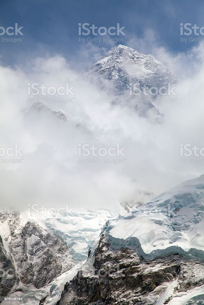 Everest. View of top of Mount Everest with clouds stock photo