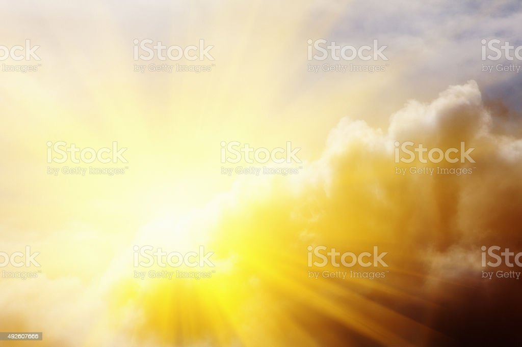 Every cloud has a silver lining: sun breaking through clouds stock photo