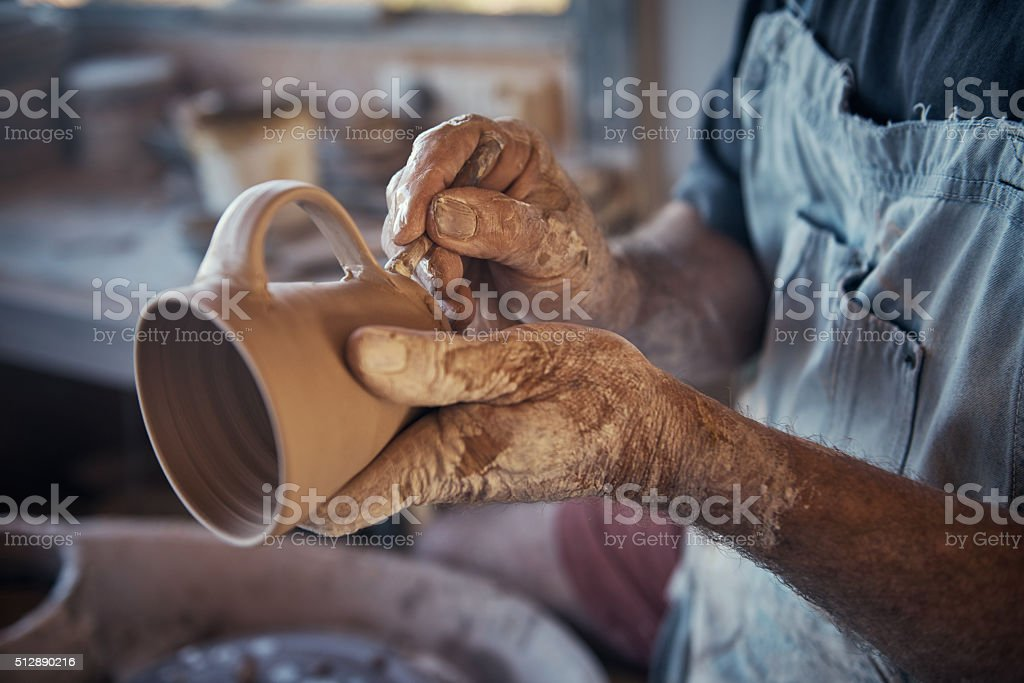 Every cup he makes is unique stock photo