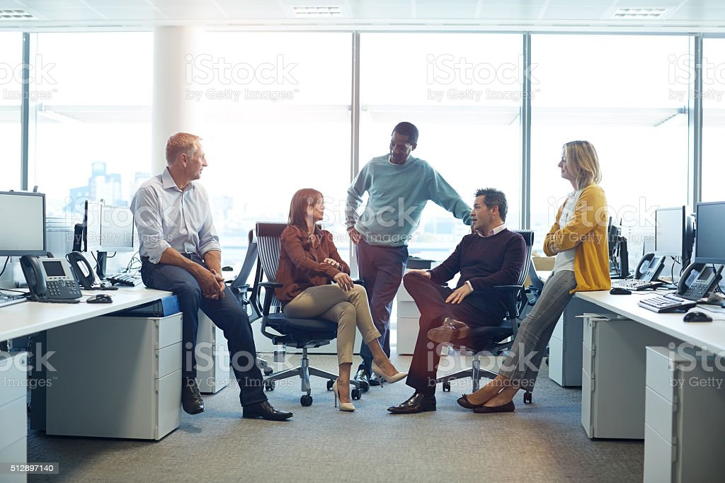 Everybody in this office is on the same page stock photo