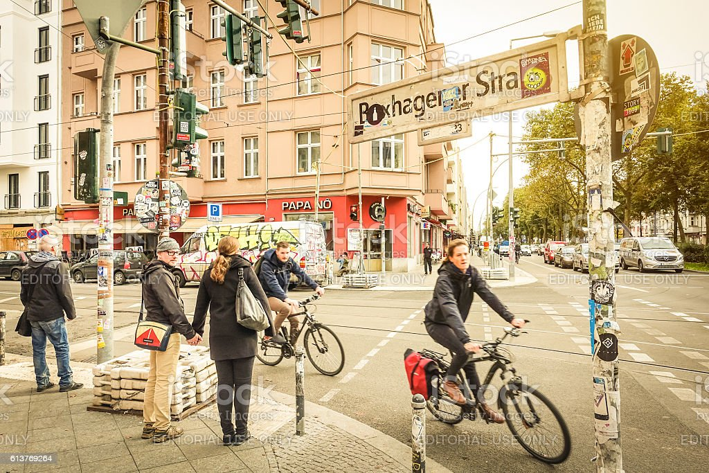 Everyday life in Berlin with bikers and pedestrians moving around stock photo