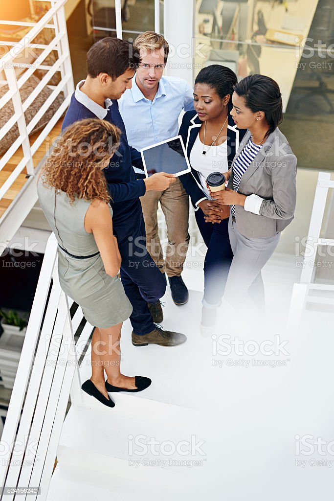 Everyone is in on this project stock photo