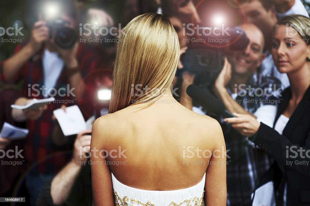 Everyone wants a piece of her - Celebrity Lifestyle stock photo