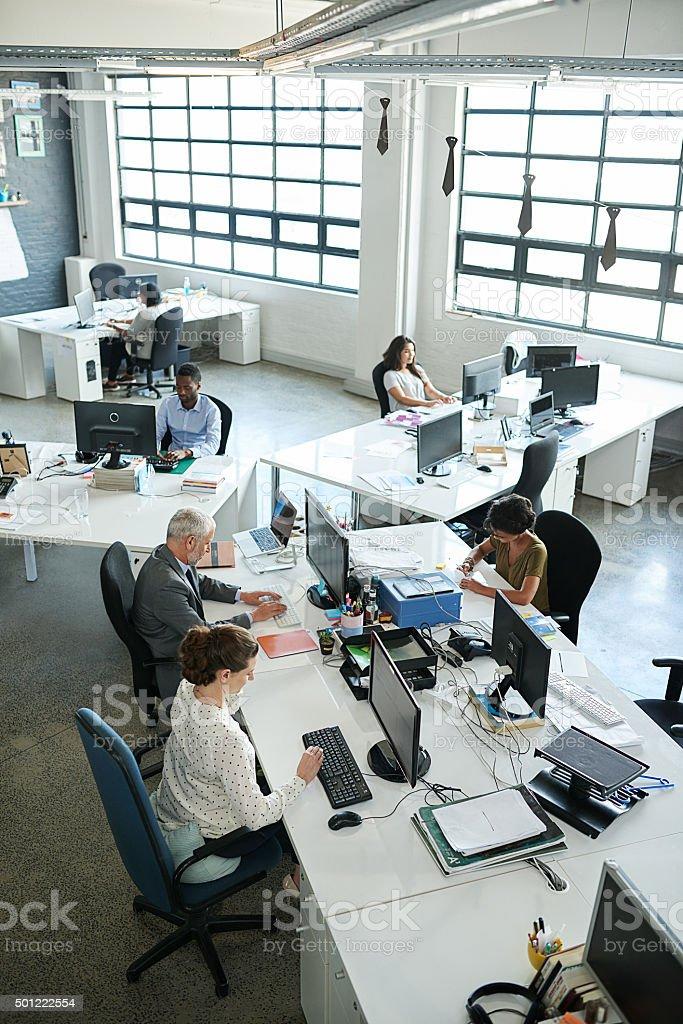 Everyone's focused on their tasks stock photo