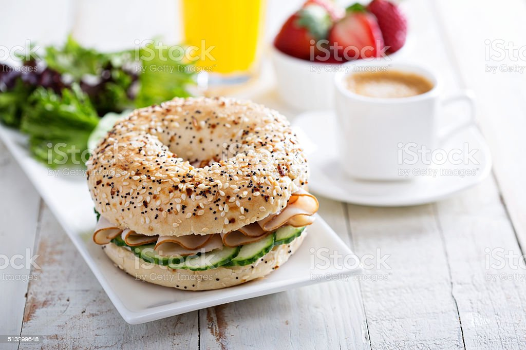 Everything bagels with cream cheese and cucumber stock photo
