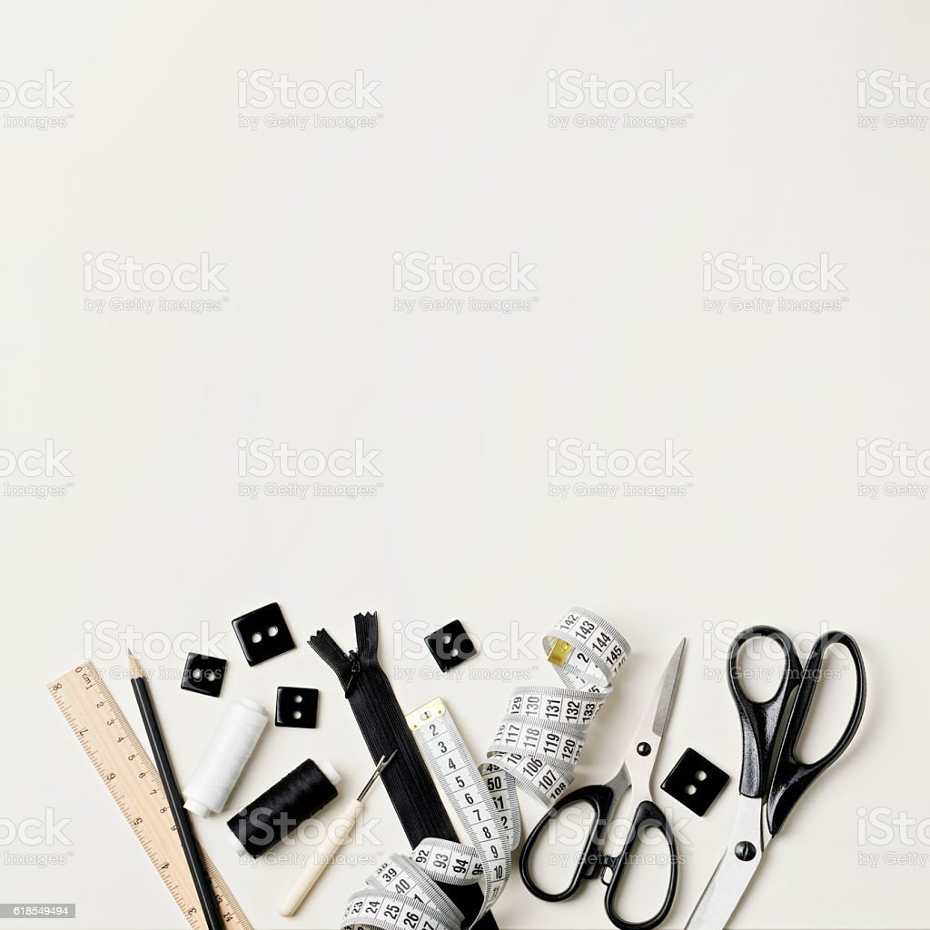 Everything for sewing in black and white. Fabric and thread, stock photo