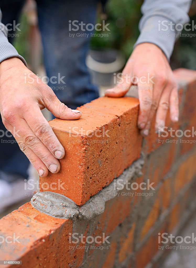 Everything is built one brick at a time stock photo