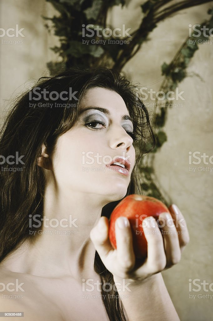 Female portraying \'Eve\' character and offering an apple while...