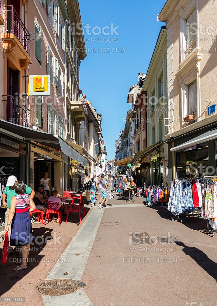 Evian-les-Bains, France. Street view with tourists walking and shops stock photo