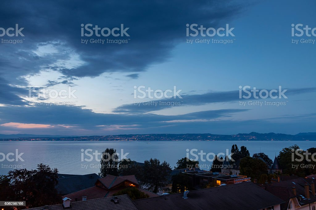 Evian-les-Bains, France. The Lake Geneva at night, with clouds stock photo