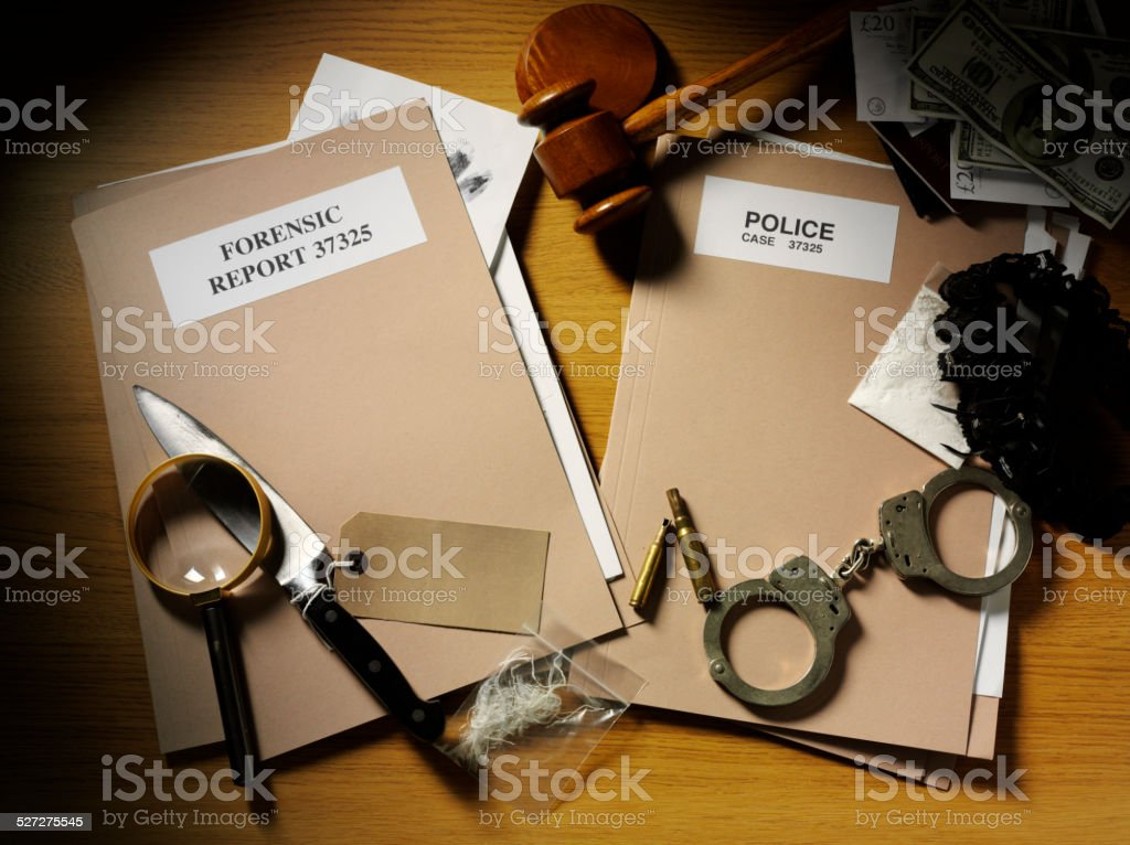 Evidence from a Crime with Handcuffs and Gavel stock photo