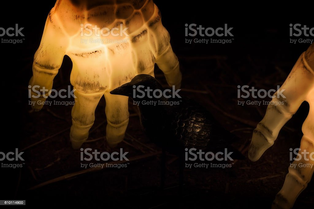 Evil Black Crow and Glowing Skeleton Hands stock photo