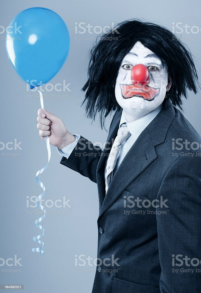 Evil clown in business suit royalty-free stock photo
