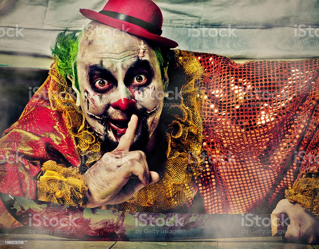 Evil Clown under bed stock photo