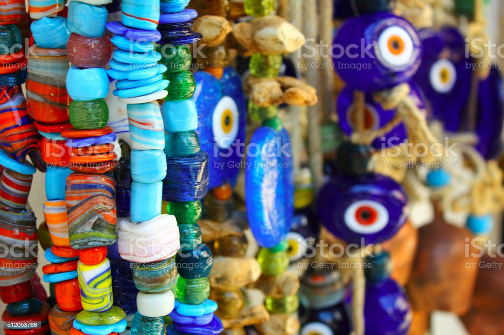 Evil eye and beads stock photo