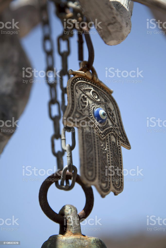 evil eye bead hanging at the door stock photo