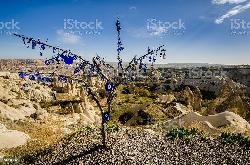 Evil eye talismans over volcanic rock landscape. stock photo