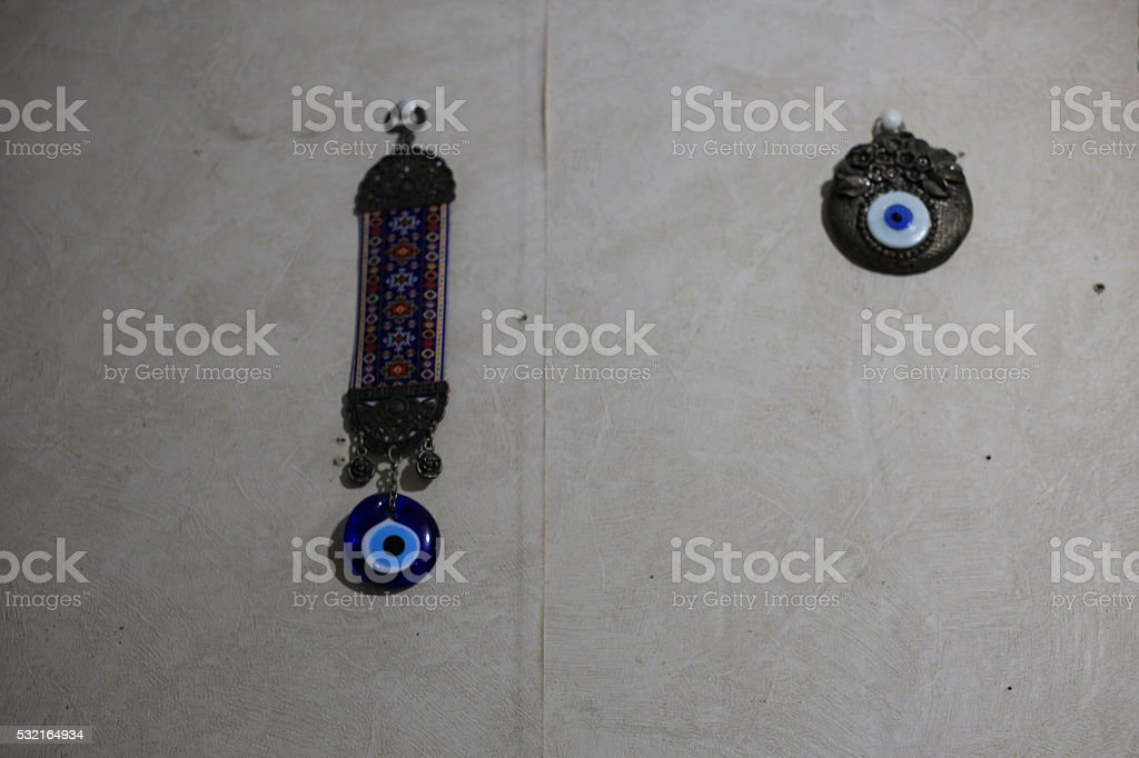 Evil eyes on the wall. stock photo