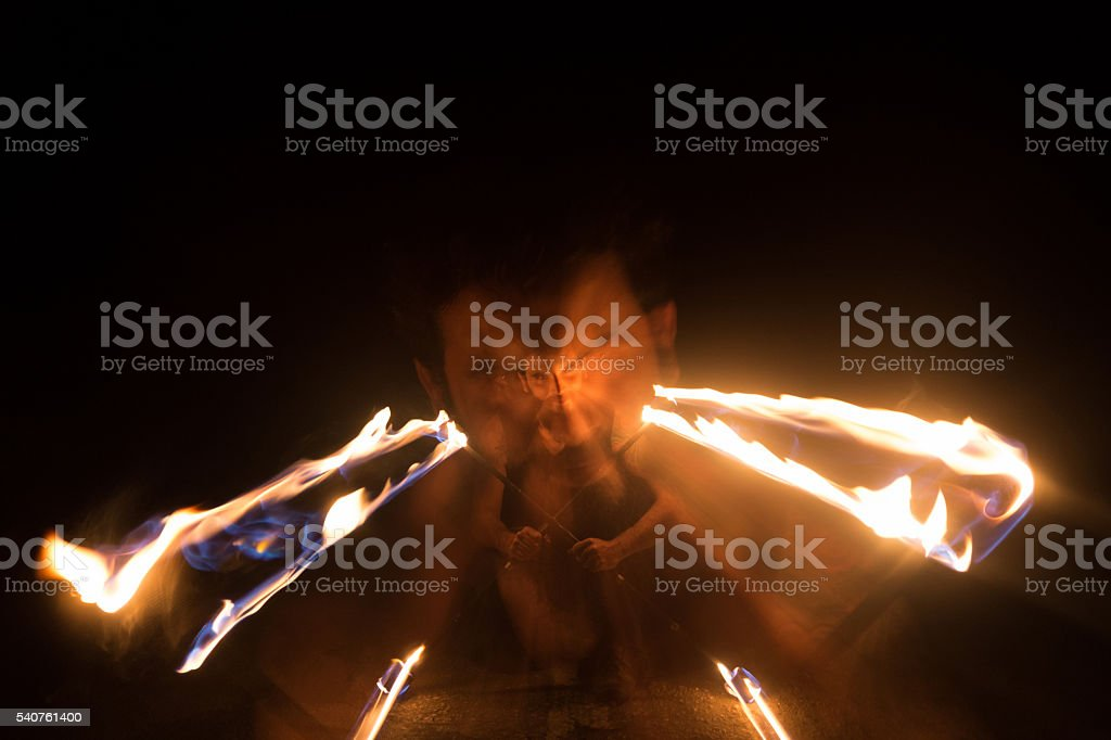 Evil Look Fire Juggler stock photo