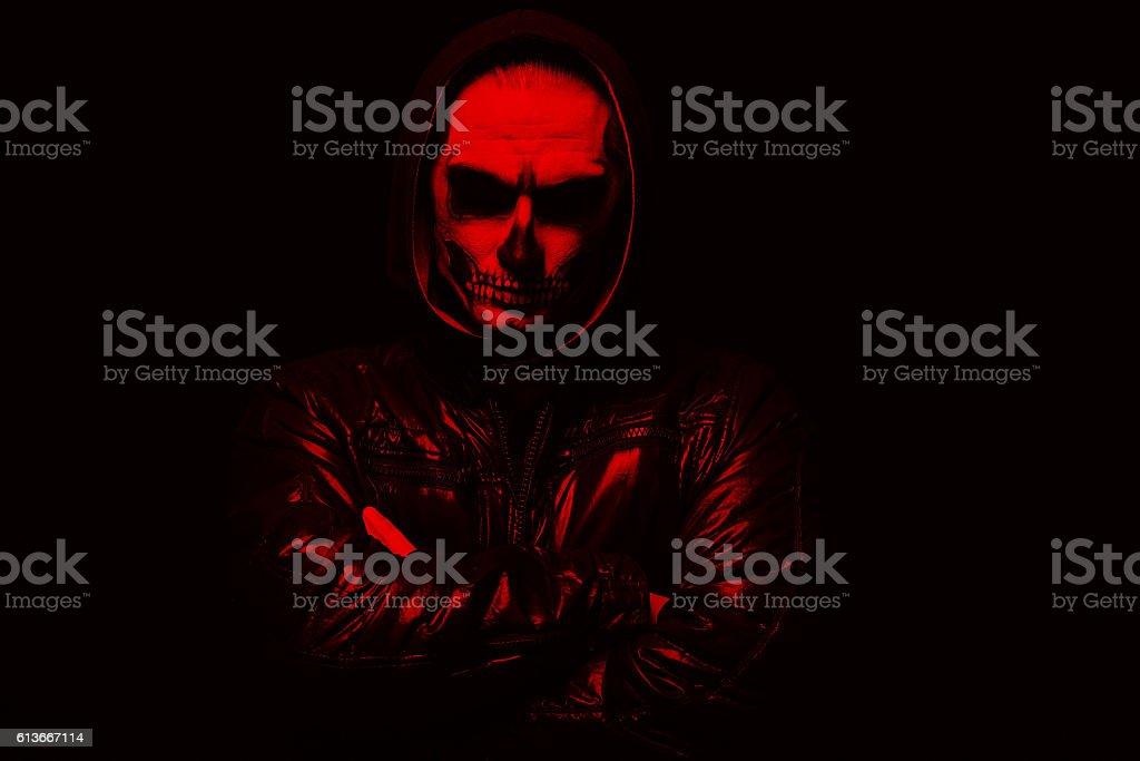 Evil man on black background stock photo