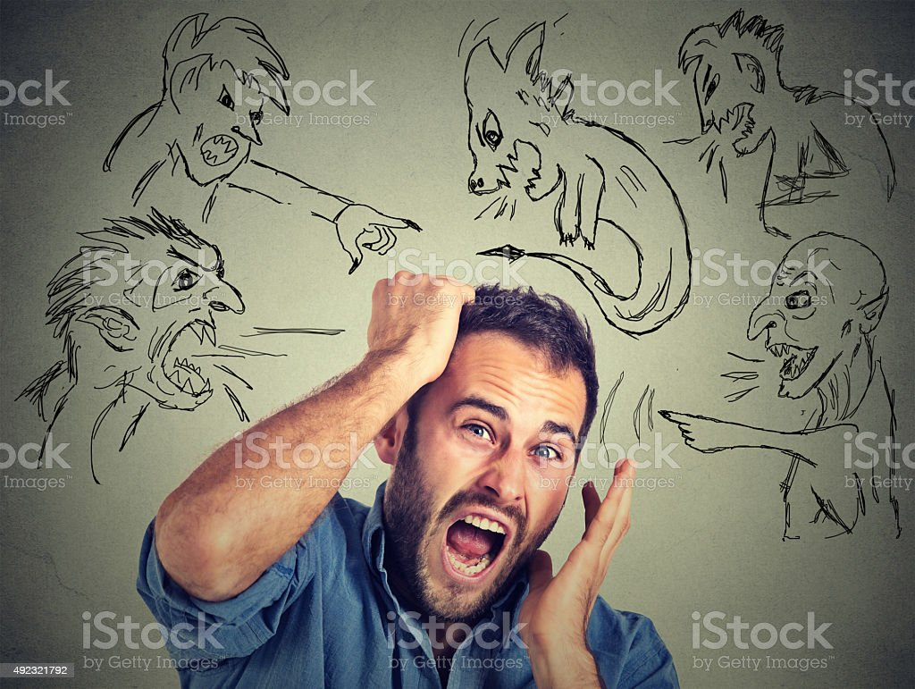 Evil men pointing at stressed anxious guy stock photo