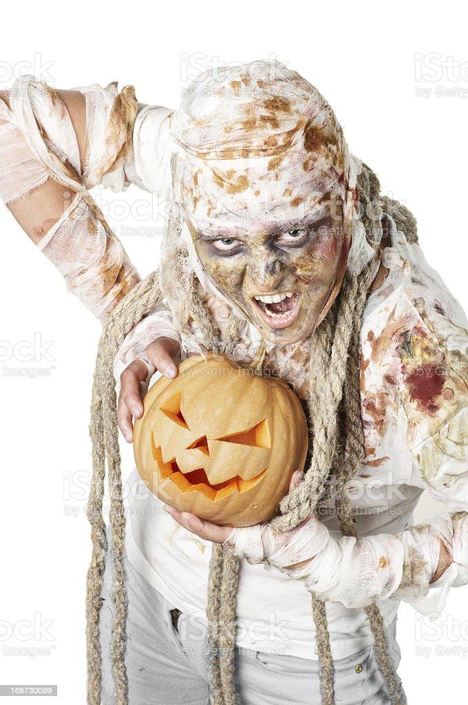 Evil mummy is holding  pumpkin royalty-free stock photo
